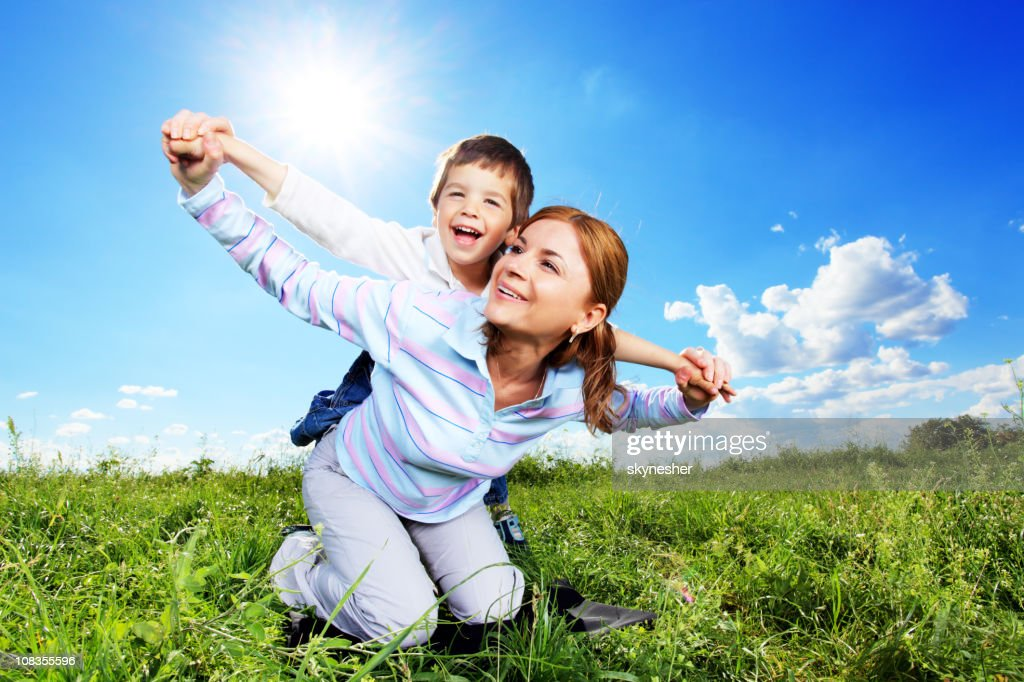 Mother and son relaxing together outdoor. : Stock Photo