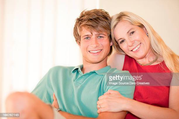 mother and son relaxing together - older woman younger man stock photos and pictures