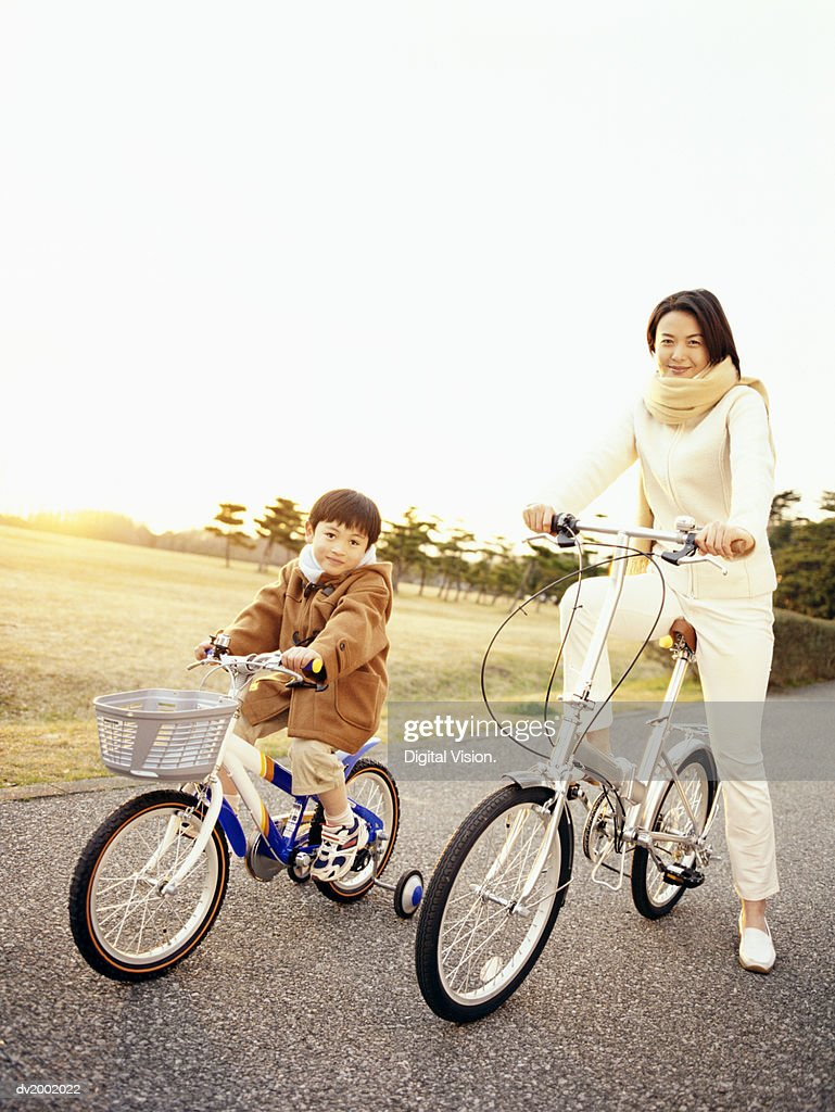 Mother and Son Riding Bicycles : Stock Photo