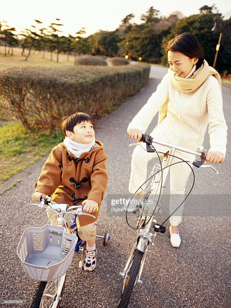 Mother and Son Riding Bicycles Together : Stock Photo