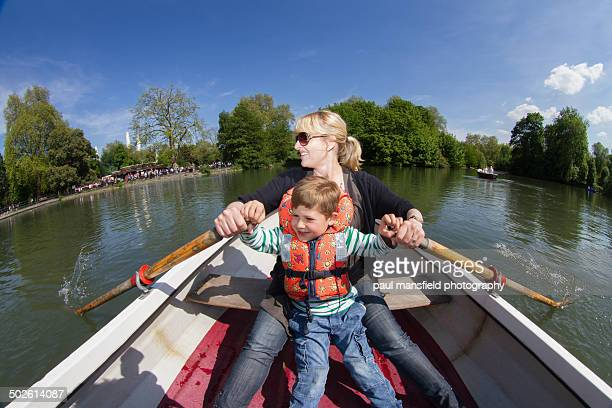 Mother and son rowing a boat