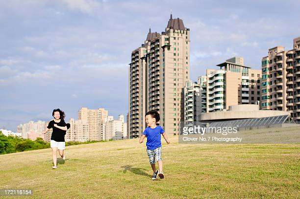 Mother and son run.