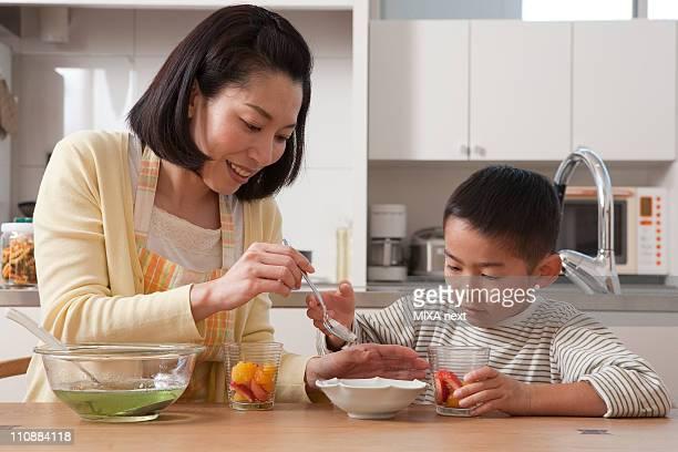 Mother and Son Serving Dessert Together