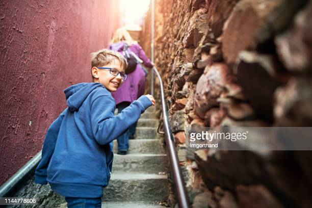 mother and son sightseeing streets and alleys of vernazza in cinque terre, italy - narrow stock pictures, royalty-free photos & images