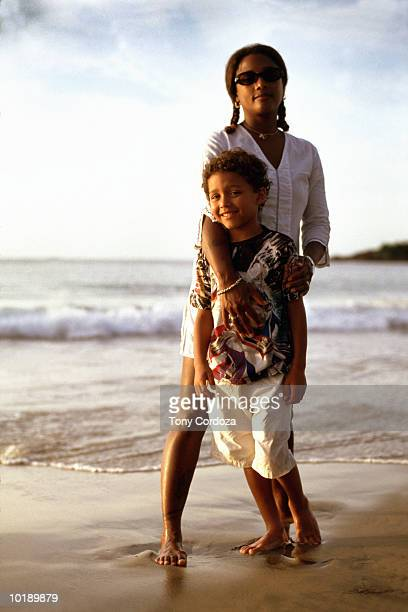 mother and son (9-11 years) standing on beach, portrait - 30 39 years ストックフォトと画像