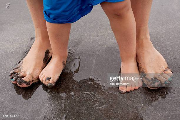 mother and son standing on wet sand - dirty feet stock pictures, royalty-free photos & images