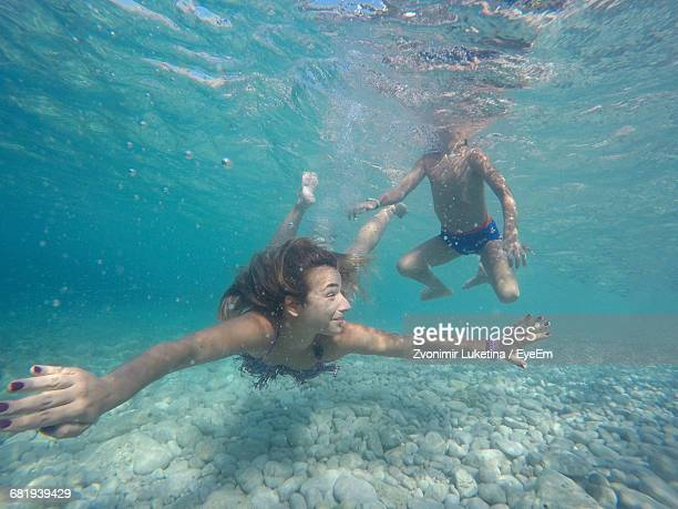 Mother And Son Swimming In The Sea