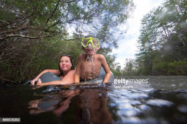 Mother and son swimming in water, Destin, Florida