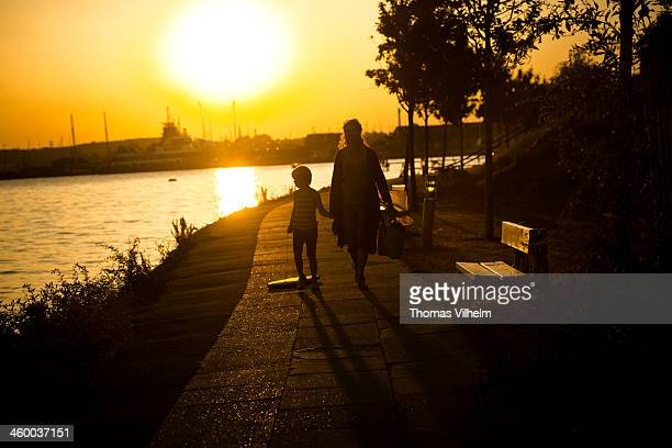 mother and son take a walk in the light of sunset - funen stock pictures, royalty-free photos & images