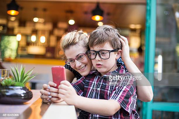 Mother and son taking selfie.