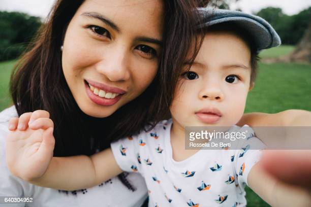 Mother and son taking selfie picture outdoors