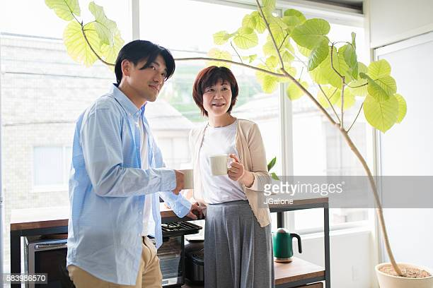 mother and son talking - japan mom and son stock photos and pictures