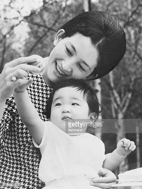 Mother and Son Tokyo Japan The lovely Crown Princess Michiko plays with her youngest son Prince Aya 10 months old in the Togu Palace garden here The...