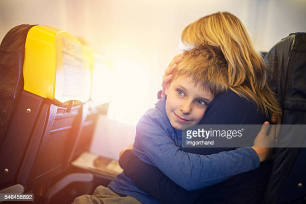 Mother and son travelling by plane