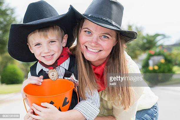 Mother and son trick or treating on Halloween