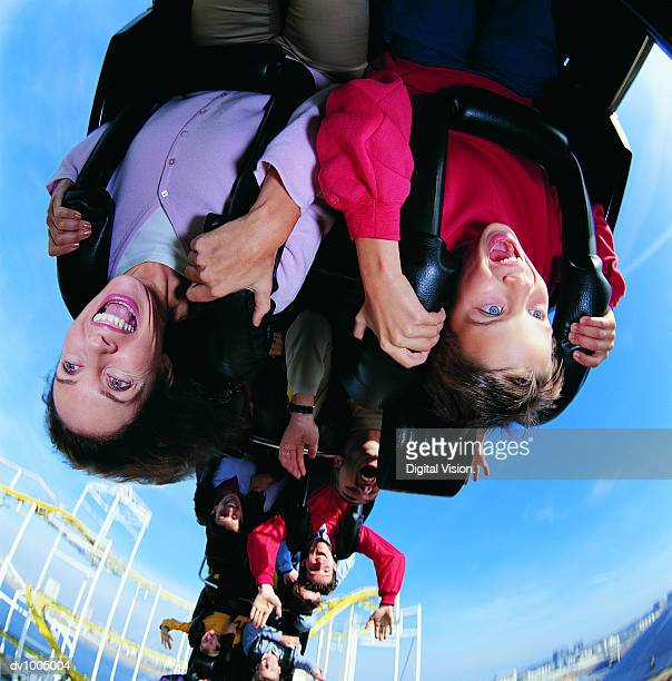 mother and son upside down on a roller coaster - upside down stock pictures, royalty-free photos & images