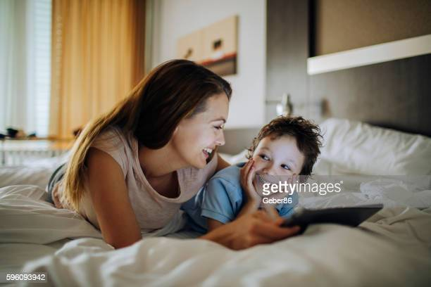 Mother and son using a digital tablet
