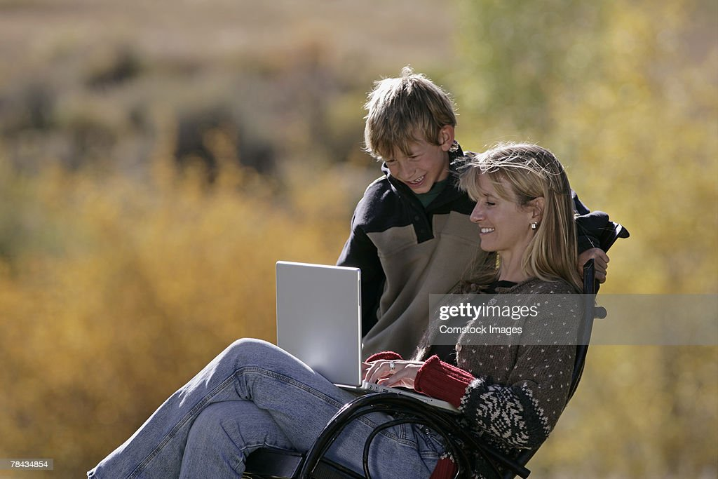 Mother and son using laptop : Stock Photo