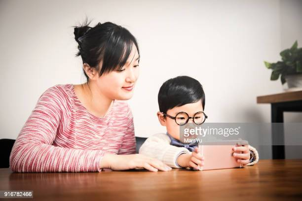 Mother and son using phone