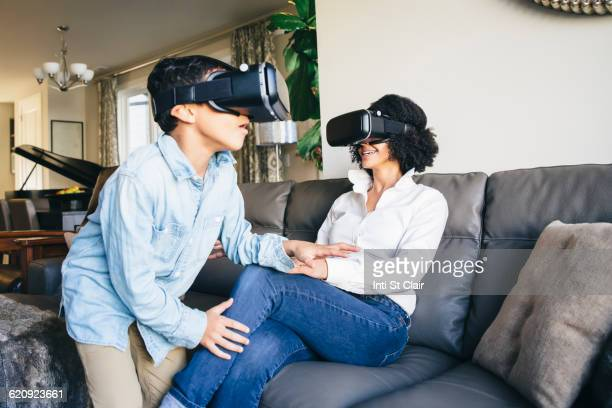 Mother and son using virtual reality goggles