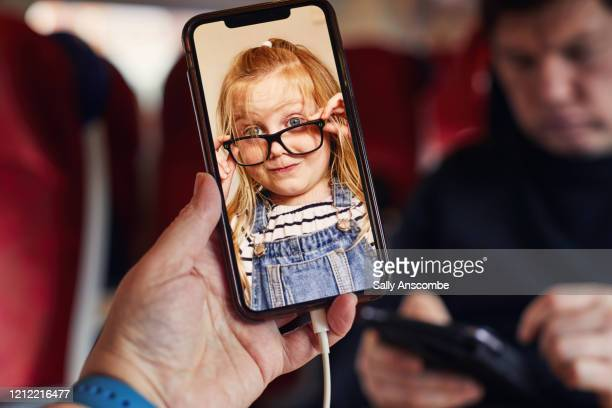 mother and son video call on the train - single mother stock pictures, royalty-free photos & images