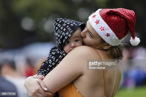 A mother and son wait for the start of the Woolworths Carols in the Domain at The Domain on December 18 2016 in Sydney Australia Woolworths Carols in...