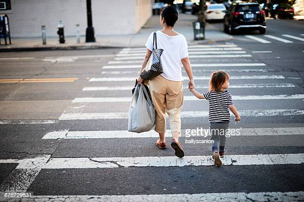 Mother And Son Walking Across Street.