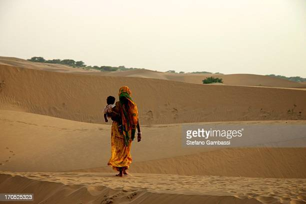 Mother and son walking in the Thar desert, Rajasthan