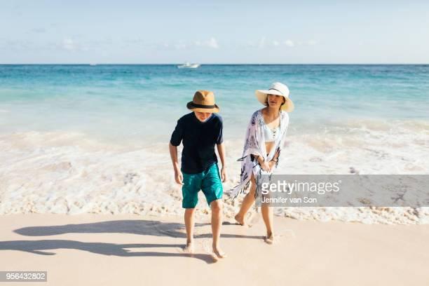mother and son walking on beach - punta cana fotografías e imágenes de stock