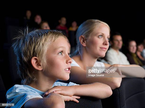mother and son watching a movie - redoubtable film stock photos and pictures