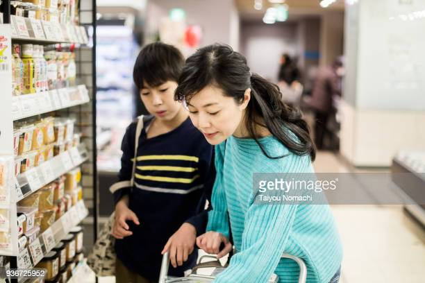 mother and son who shops at supermarket - japan mom and son stock photos and pictures