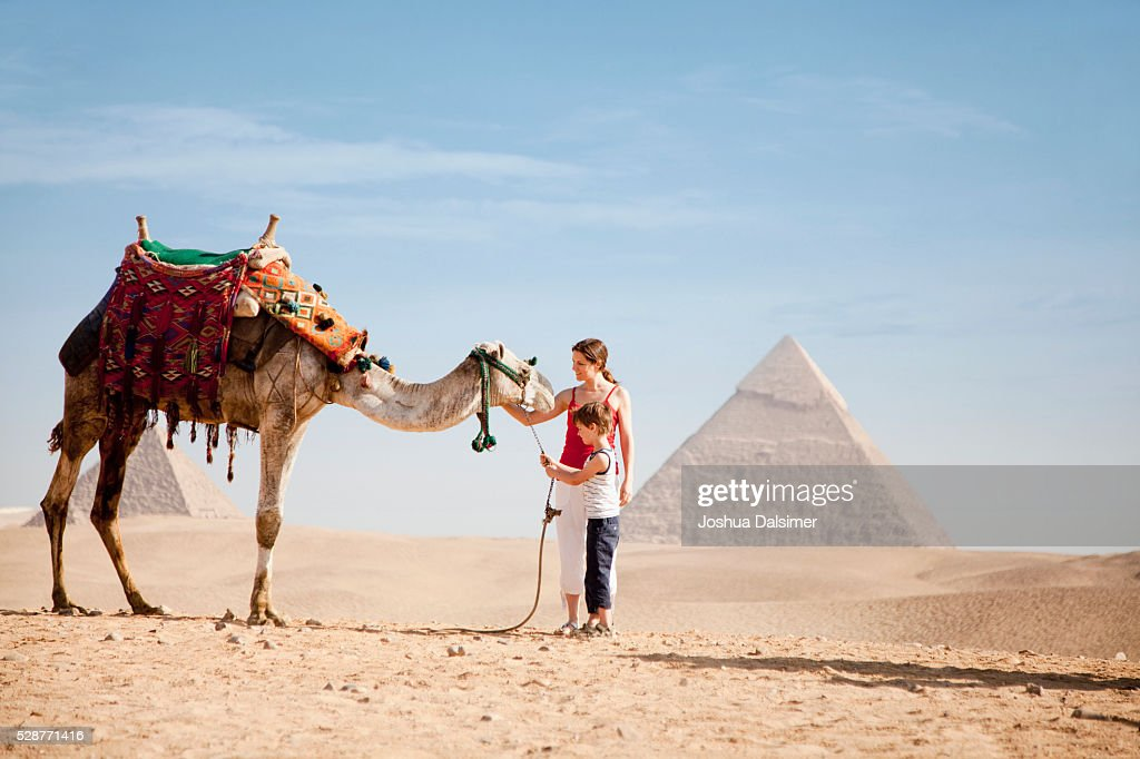 Mother and son with a camel : Stock Photo