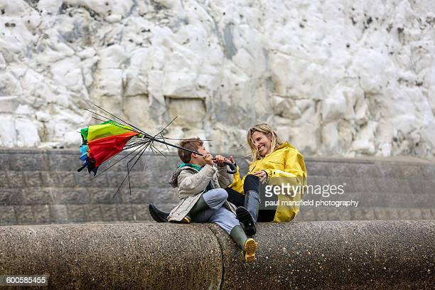 Mother and son with broken umbrella