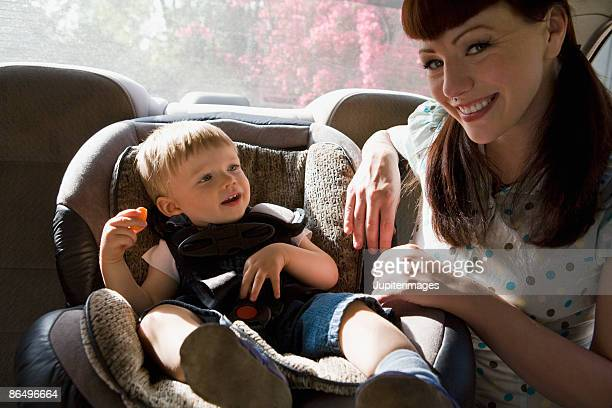 Mother and son with car seat