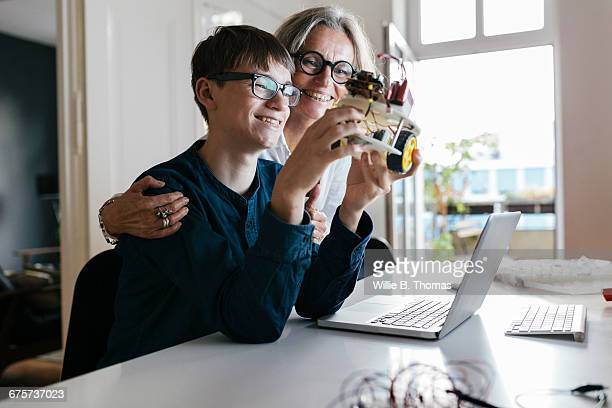 Mother and son with completed electronic project