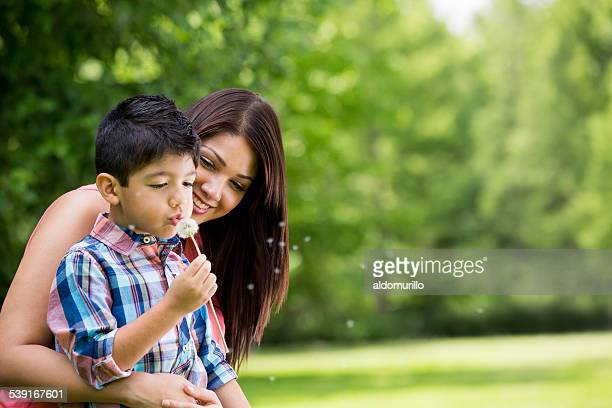 Mother and son with dandelion