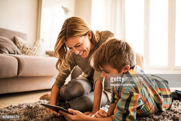 mother and son with digital tablet - mother and son stock photos and pictures