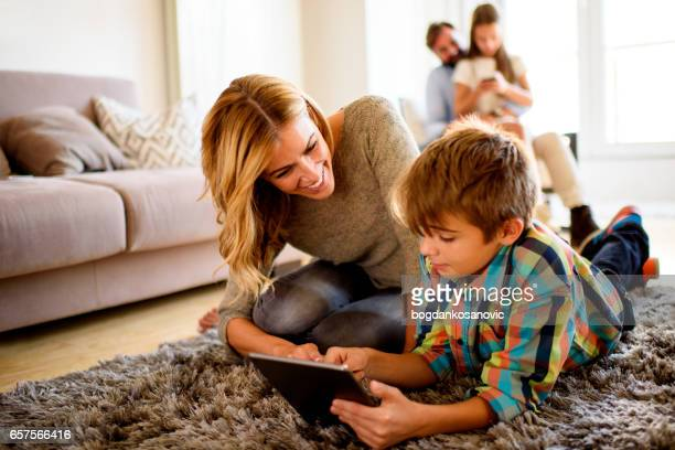 Mother and son with digital tablet