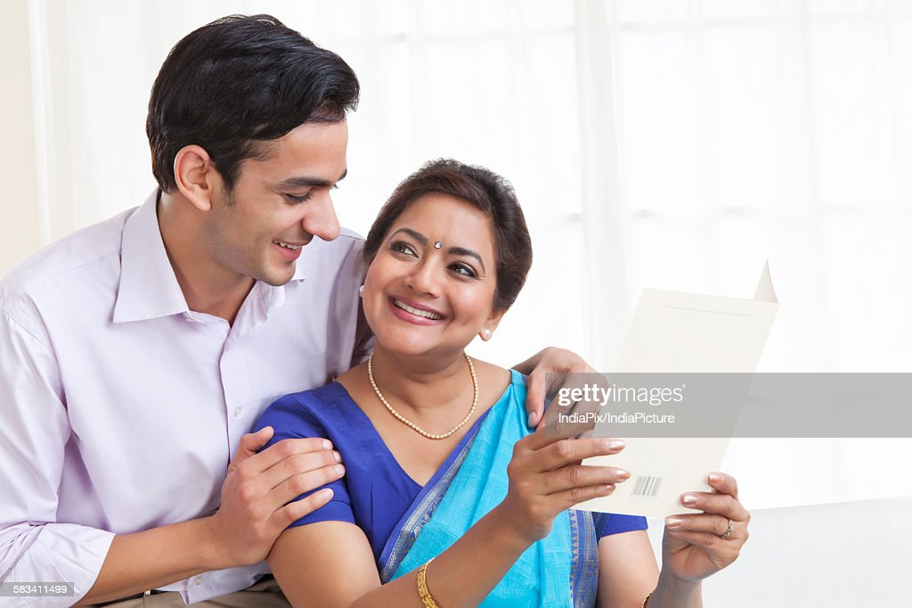Mother and son with greeting card : Stock Photo