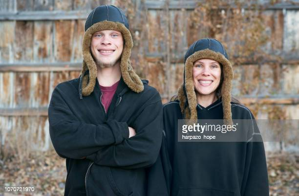 mother and son with matching hats. - tall person stock pictures, royalty-free photos & images