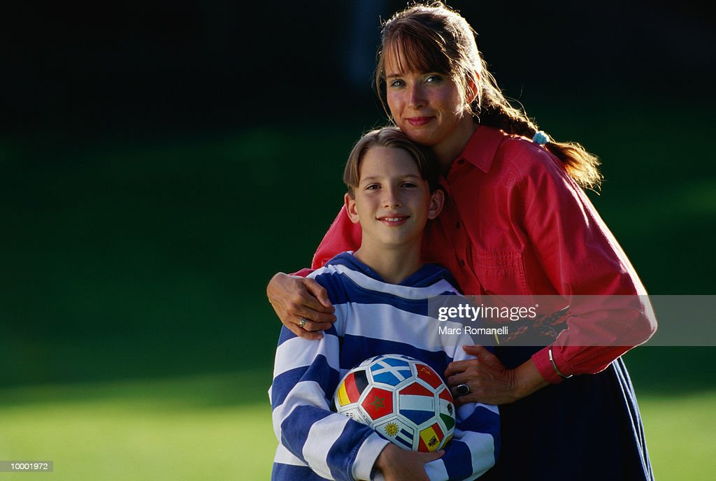 Mother and son (9-11) with soccer ball, portrait : Stock Photo