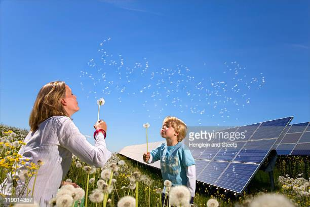 mother and son with solar panels - solar panels stock photos and pictures
