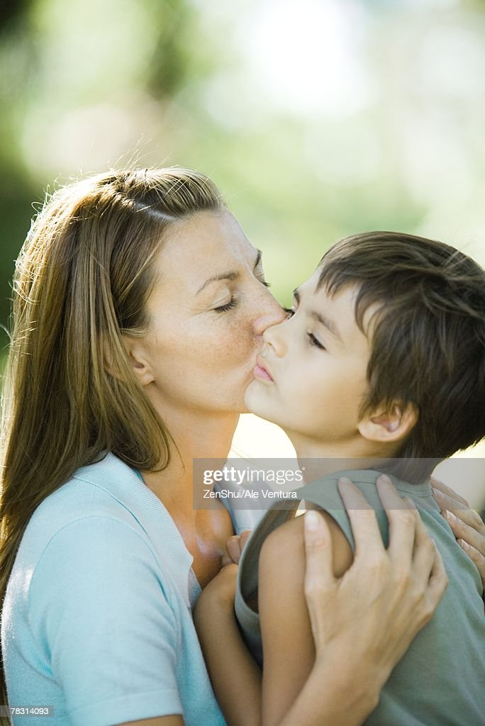 Mother And Son Woman Kissing Boy On Cheek High-Res Stock -9420