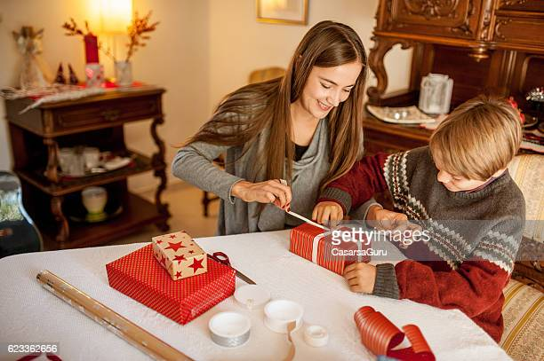 Mother and Son wrapping Christmas Gifts