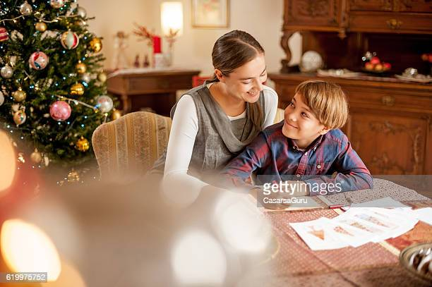 Mother and Son Writing a Christmas Card