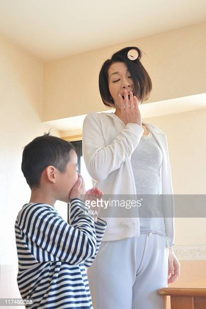 mother and son yawning together - yawning mother child stock photos and pictures