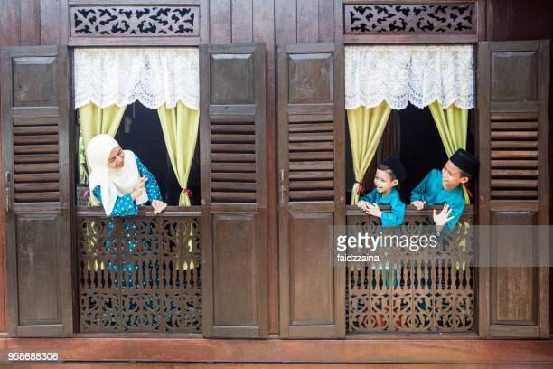 mother and sons celebrates on eid-ul-fitr/ aidilfitri / hari raya - malay stock photos and pictures