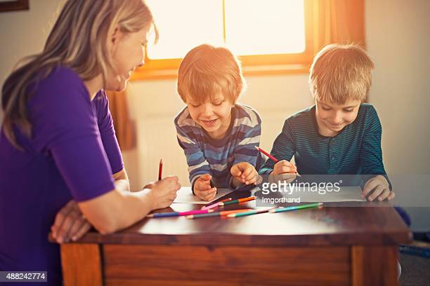 Mother and sons drawing together