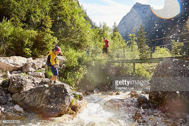 Mother and sons exploring, H_llental, Zugspitze, Garmisch-Partenkirchen, Bavaria, Germany