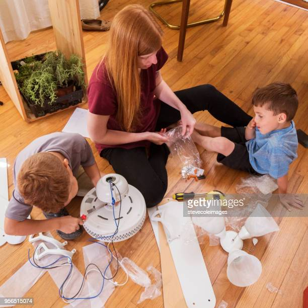 Mother and sons helping each other.
